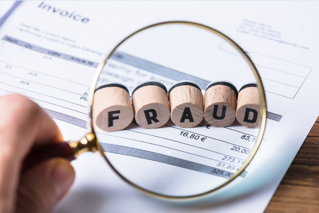 Magnifying Glass Focusing in on the Word Fraud